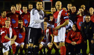 British Army football captain Keith Emmerson and the German Bundeswehr football captain Alexander Hess shake hands