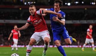 Jack Wilshere and Leighton Baines go shoulder-to-shoulder at the Emirates