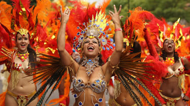 LONDON, MONDAY: Dancers take part in the Notting Hill Carnival, the capital's annual celebration of Caribbean culture.