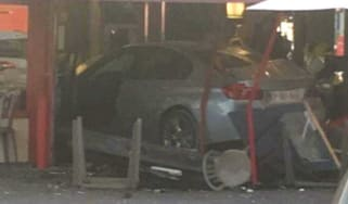 A BMW deliberately driven into a pizzeria on Paris outskirts