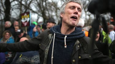 BARTON, ENGLAND - MARCH 17:Happy Mondays star Bez joins protesters blocking lorries trying to enter the Barton Moss fracking exploration site March 17, 2014 in Barton, England. Bez (Mark Berr