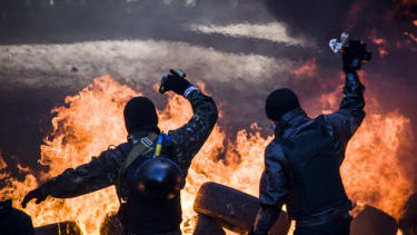 Anti-government demonstrators clash with riot police in central Kiev on February 18, 2014. Opposition leader Vitali Klitschko on February 18 urged women and children to leave the opposition's