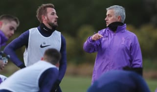 Tottenham striker Harry Kane speaks with new head coach Jose Mourinho at training