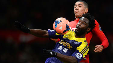 Wilfried Bony and Chris Smalling battle for the ball