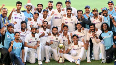 India celebrate their victory against Australia at The Gabba
