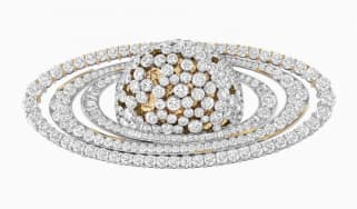 A Van Cleef & Arpels Saturn brooch in gold with diamonds