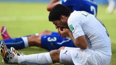Luis Suarez and Giorgio Chiellini after their clash in Natal