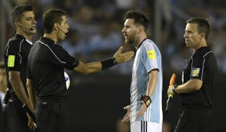 Lionel Messi; Argentina; argues with referee
