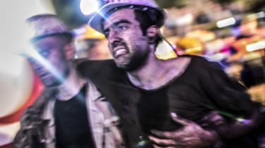 Injured miner is carried by rescuers in Turkey