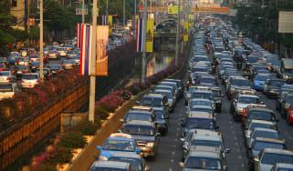 BANGKOK-THAILAND - JANUARY 25: Cars move slowly during rush hour traffic January 25, 2006 in Bangkok, Thailand. According to reports Bangkok estimates that it loses 6 percent of its economic