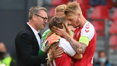 Simon Kjaer comforts Christian Eriksen's partner Sabrina Kvist Jensen