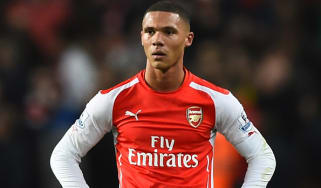 Kieran Gibbs of Arsenal looks dejected after the Barclays Premier League match between Arsenal and Manchester United