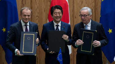 Donald Tusk, Shinzo Abe and Jean-Claude Junker sign the trade deal on Tuesday