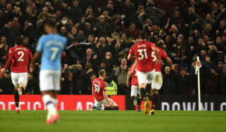 Man United fans and players celebrate Scott McTominay's goal against Man City