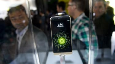 Visitors look at the new LG G5 model of South Korean multinational conglomerate corporation LG after its presentation on the eve of the official start of the Mobile World Congress in Barcelon