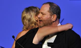 Harvey Weinstein embraces the actress Sharon Stone in 2015