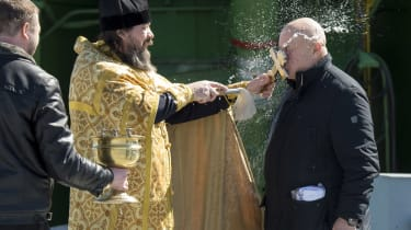 BAIKONUR, KAZAKHSTAN - MARCH 26: An Orthodox Priest blesses Sergey Semchenko of the Russian Search and Recovery Forces after having blessed the Soyuz rocket at the Baikonur Cosmodrome Launch