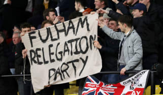 Fulham fans hold up their banner after being relegated at Watford's Vicarage Road