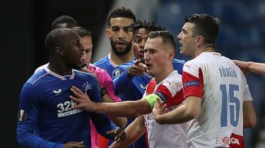 Glen Kamara of Rangers clashes with Slavia Prague's Ondrej Kudela