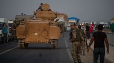 AKCAKALE, TURKEY - OCTOBER 09: People wave as Turkish soldiers prepare to cross the border into Syria on October 09, 2019 in Akcakale, Turkey. The military action is part of a campaign to ext