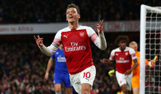 Mesut Ozil celebrates his goal in the 3-1 win against Leicester in the Premier League