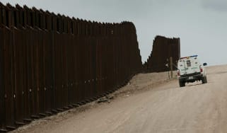 US Customs and Border Protection patrol a section of the existing border fence