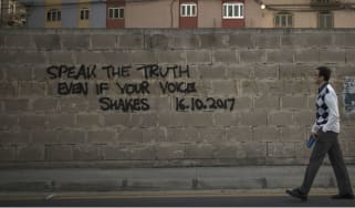 A tribute for the murdered journalist Daphne Caruana Galizia is sprayed on a wall in Valletta, Malta