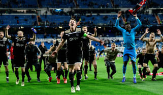 Ajax players celebrate their stunning win against Real Madrid at the Bernabeu