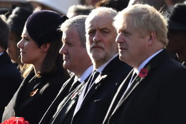 LONDON, ENGLAND - NOVEMBER 10:Britain's Prime Minister Boris Johnson (R) and Britain's Labour Party leader Jeremy Corbyn prepare to lay wreaths as they take part in the annual Remembrance Sun