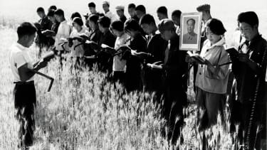 Thought to be a propaganda picture set up during the Great Proletarian Cultural Revolution. The Cultural Revolution was launched in May 1966 by Mao who hoped to recapture power after the failure of the Great Leap Forward