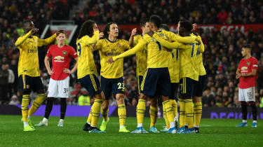 Pierre-Emerick Aubameyang is congratulated by his Arsenal team-mates after equalising at Old Trafford