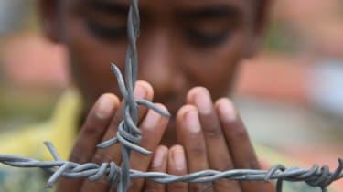 A Rohingya performs prayers at the Kutupalong refugee camp in Bangladesh