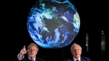 David Attenborough and Boris Johnson sit beneath projected moon