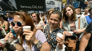Hundreds of people rinse with mouthwash in Times Square June 25, 2013 during an event to promote Colgate-Palmolive Co.'s Colg