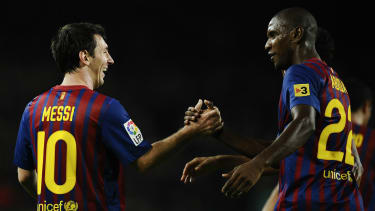 Lionel Messi and Eric Abidal were formerly team-mates at Barcelona