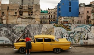 A man repairs his car in Havana, Cuba