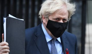 Boris Johnson leaves Downing Street for parliament for the vote on the new UK tier system