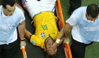 Neymar is carried off the pitch after being injured in Brazil's quarter-final against Columbia