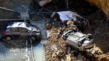 A sinkhole swallows cars in Rome in 2018