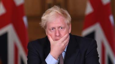 Boris Johnson attends a virtual press conference