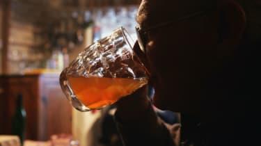 Man drinking a pint.