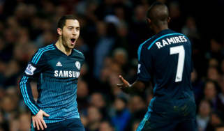 Eden Hazard of Chelsea celebrates with a teammate
