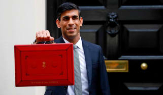 Chancellor of the Exchequer Rishi Sunak poses with the Budget Box outside 11 Downing Street