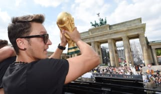 Mesut Ozil celebrates Germany's World Cup triumph
