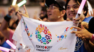 TOKYO, JAPAN - SEPTEMBER 08:Residents of Olympic bid city Tokyo celebrate while holding Tokyo signs after the announcement of the 2020 Summer Olympic Games host city at Komazawa Olympic Park