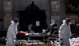 Medics evacuate a hunger striker from St John the Baptist church at the Béguinage in Brussels
