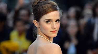 """British actress Emma Watson poses for pictures on the red carpet as she arrive for the UK premiere of her latest film """"Noah"""" in Leicester Square, central London, on March 31, 2014. AFP PHOTO/"""
