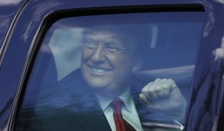 Donald Trump waves to supporters lined along on the route to his Mar-a-Lago estate.