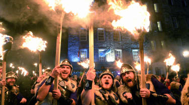 EDINBURGH, SCOTLAND - DECEMBER 30:Men dressed as Vikings take part in the torchlight procession as it makes its way through Edinburgh for the start of the Hogmanay celebrations on December 30