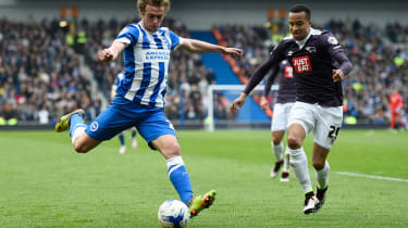 Brighton striker James Wilson takes on Marcus Olsson of Derby County